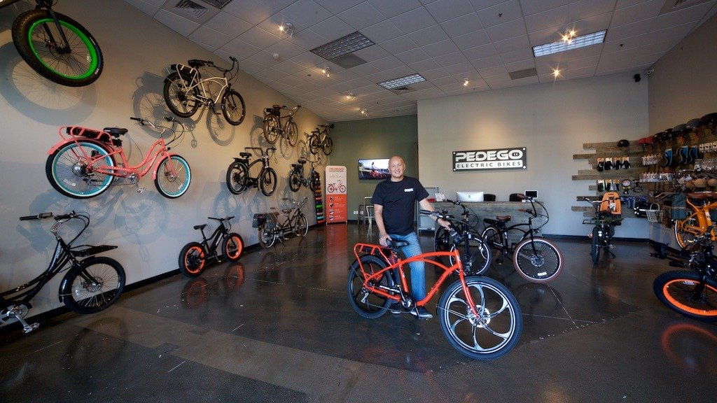 Owner Allan Lat shows off his fleet of Pedego electric bikes