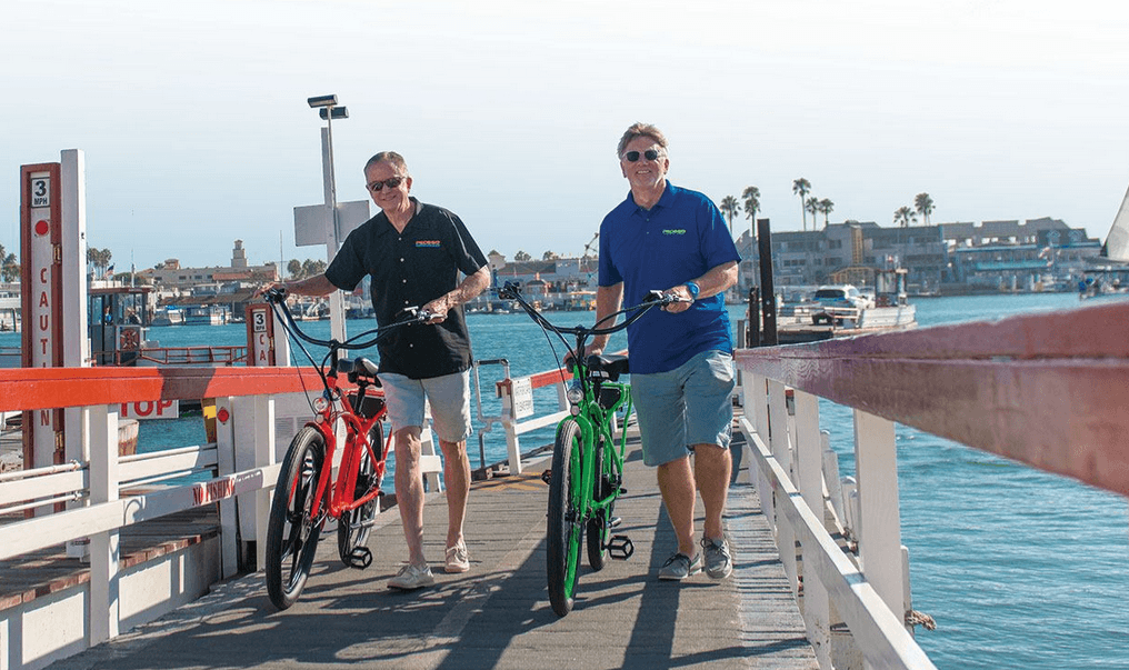 Pedego CEO and co-founder Don DiCostanzo (right) rides with CFO and co-founder Terry Sherry