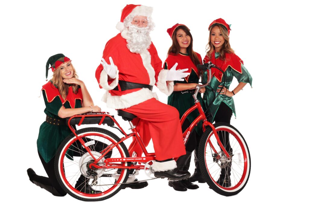 Santa and elves with Pedego Comfort Cruiser Electric Bike