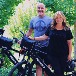Valerie Bertinelli with her husband posing with their Pedego Electric Bikes