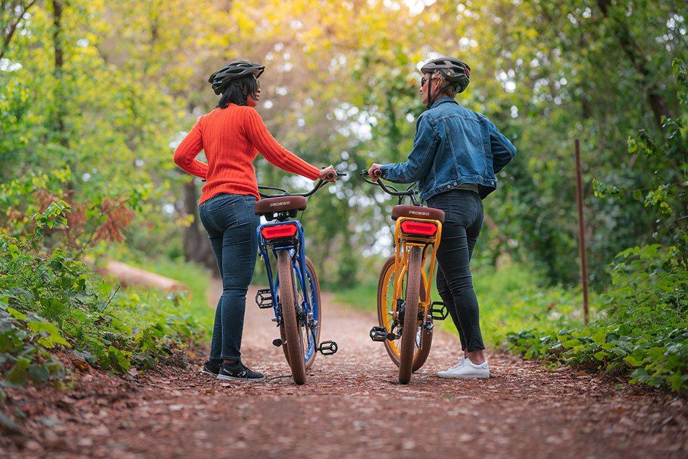 Women enjoying nature with Pedego bikes